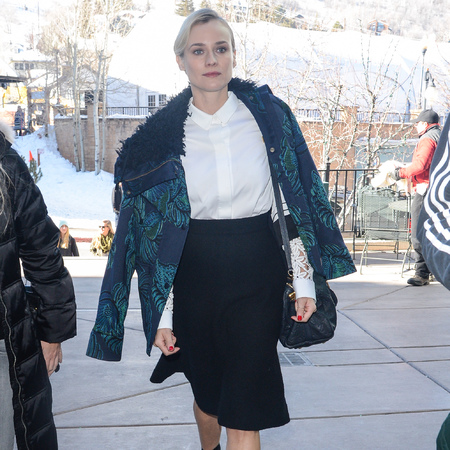Diane Kruger - sundance film festival - louis vuitton handabg - black skirt blue and green coat - style - handbag.com