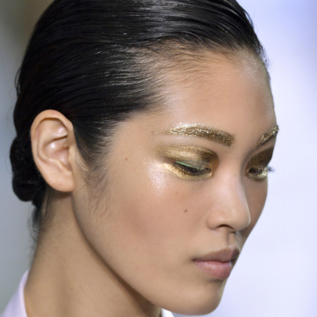 gold gliter makeup at dior spring/summer 2014 fashion week show - how to wear glitter makeup as a grown up - makeup and beauty trends - handbag.com