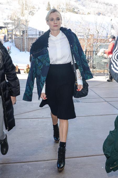 Diane Kruger - sundance film festival - louis vuitton handabg - black skirt blue and green coat - style - handbag.com