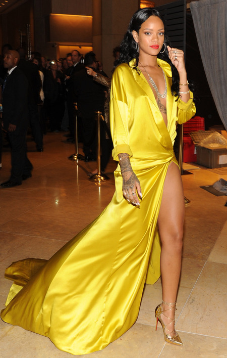 Rihanna wearing shiny yellow dress