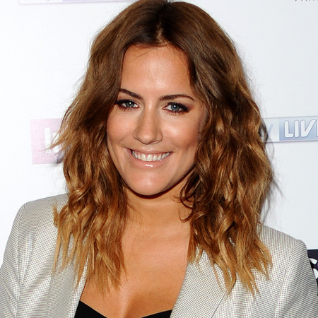 caroline flack beachy waves hairstyle and nude lipstick trend - silver shorts and blazer outfit - celebrity fashion and beauty trends - handbag.com