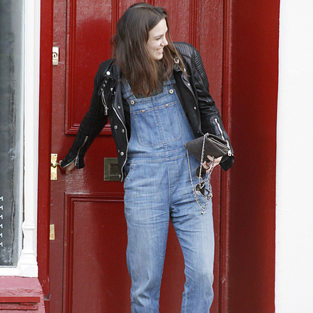 Keira Knightley wearing Burberry black leather jacket - denim dungarees trend - celebrity fashion trends - handbag.com
