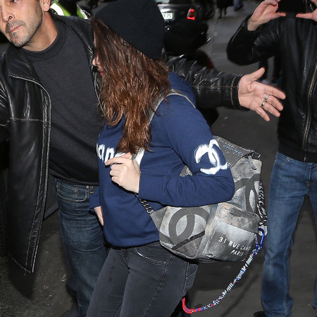 kristen stewart carrying chanel canvas logo backpack - spring summer 2014 collection - kristen stewart style - handbag.com