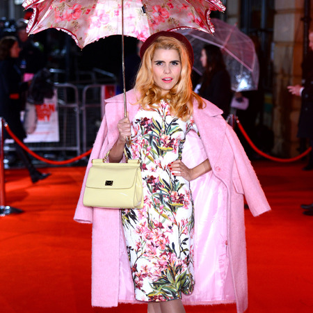 paloma faith wearing spring fashion trends in the rain - how to wear spring trends now - pink coat fashion trend - celebrity style - handbag.com