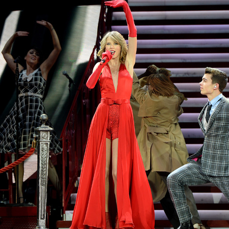 taylor swift in red leotard and split dress - taylor swift red tour - celebrity fashion trend - handbag.com