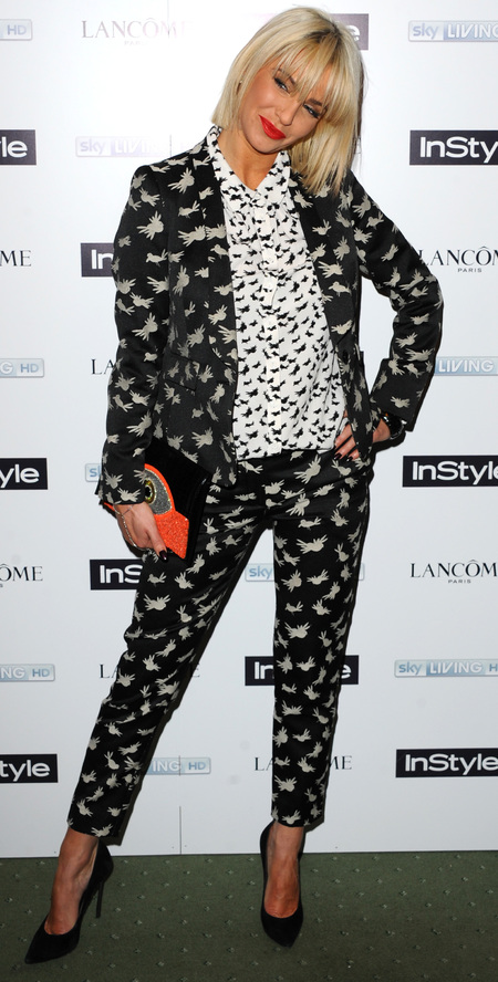Sarah Harding in bird print trousers, shirt and blazer