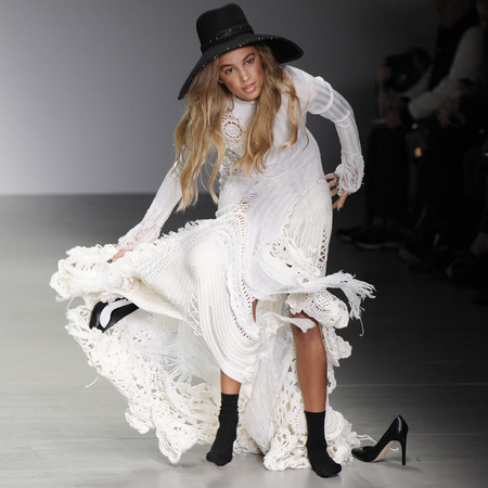 model falls on the runway at london fashion week - sibling autumn winter 2014 show - handbag.com