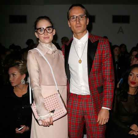 rosie fortescue and oliver proudlock made in chelsea at london fashion week - handbag by Sara Battaglia - celebrity front row fashion trends - tartan suit - handbag.com