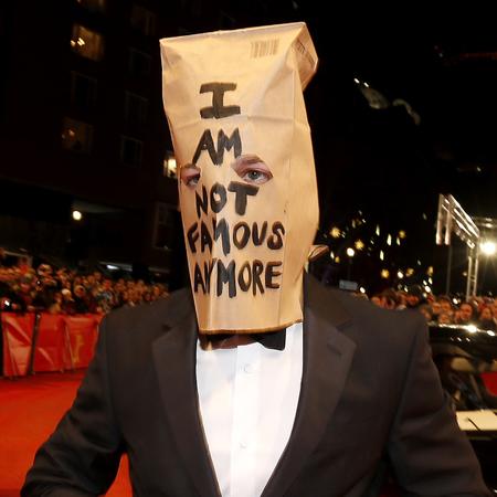 Shia LaBeouf art project #IAMSORRY - wearing brown paper bag on head - celebs who do art - controversial celebrities - celeb news - handbag.com