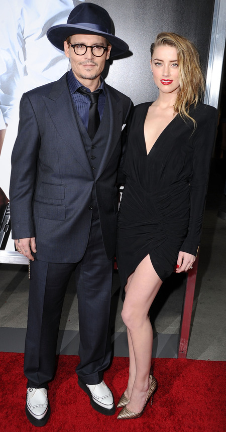 johnny depp and amber heard - red lipstick and engagement ring - short black dress - celebrity fashion trend - handbag.com