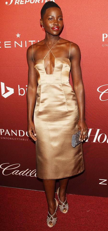 Lupita Nyong'o in gold Valentino dress at AARP's Movies for Grownups Awards Gala