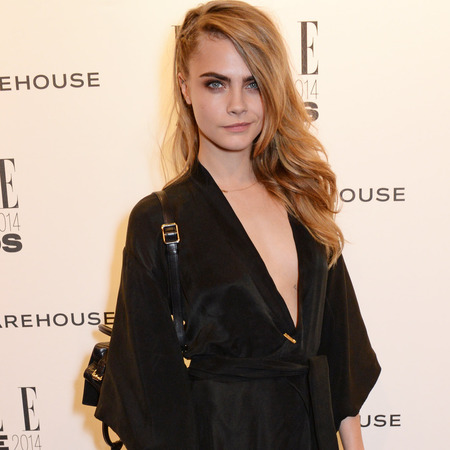 elle style awards - cara delevingne in black dress thigh split - celebrity fashion trends - handbag.com