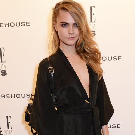 elle style awards - cara delevingne in black dress thigh split - celebrity fashion trends - handbag.com