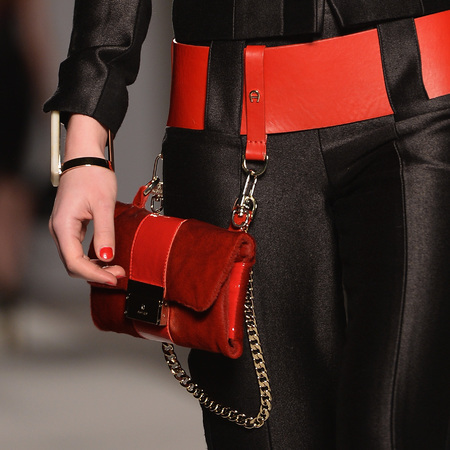new way to carry handbag on belt - red clutch bag from aigner milan fashion week collection - autumn winter 2014 - designer handbag trends - handbag.com