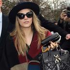 Cara Delevingne's carrying a Cara Delevingne