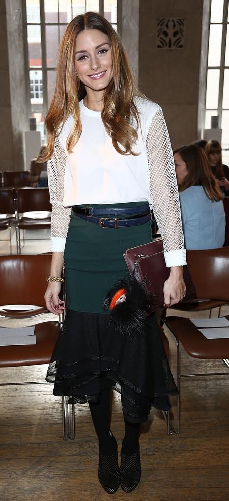 Olivia Palermo's burgundy clutch and Fendi monster keyring