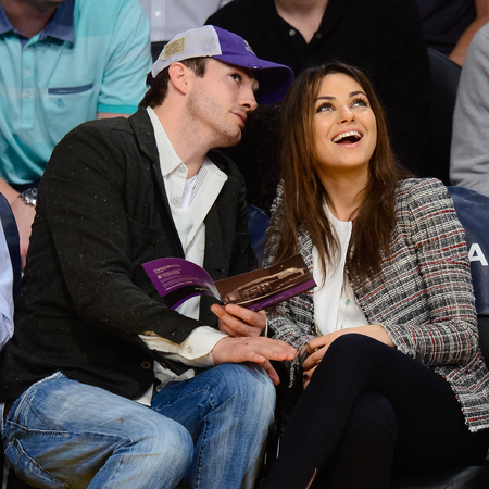 Mila Kunis with Ashton Kutcher at Lakers game March 4th - engagement ring - day bag - LA - celeb news - handbag.com
