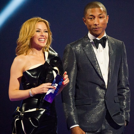 Kylie Minogue with pharrell_ williams at Brits - album launch kiss me once - facebook HQ 2014 - relationships - shopping bag - handbag.com