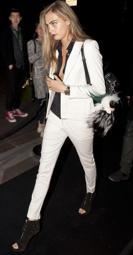 cara delevingne white suit and sheer black shirt - mulberry backpack bag and fendi karl lagerfeld bag pom pom - celebrity fashion and designer handbags - handbag.com