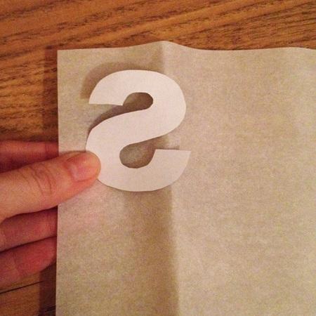 DIY Fashion fix - how to make your own slogan flower sweatshirt - trace letters onto bondaweb - step 2- handbag.com