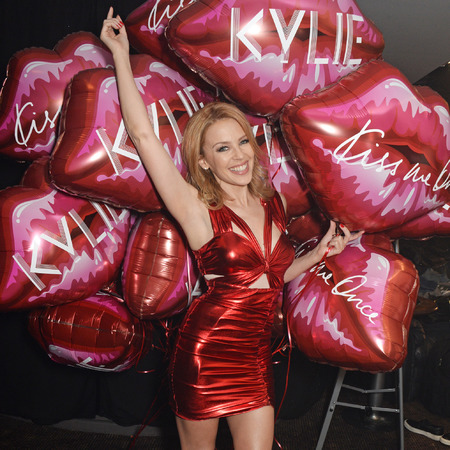 Kylie Minogue - quality street - red shiny latex dress - gay - handbag.com