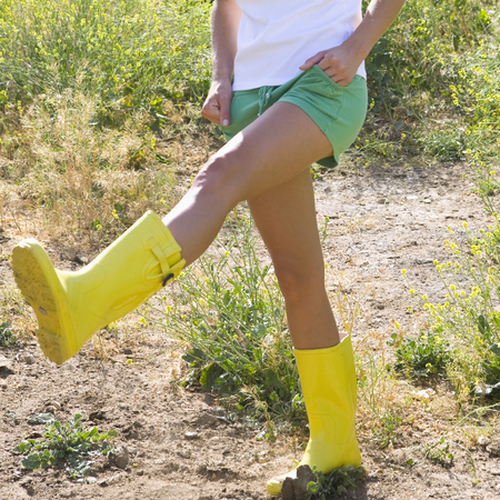woman wearing shorts and wellies - women in field - go green - evironmental t-shirt - handbag.com