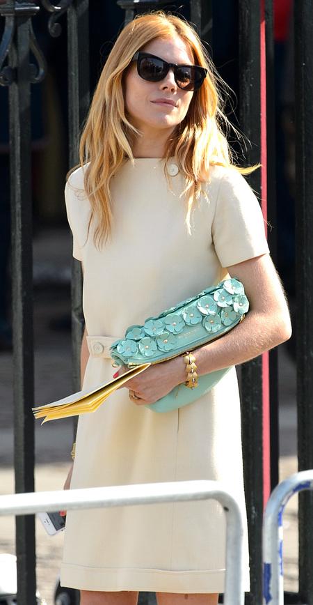 Sienna Miller at Sir David Frost Memorial - burberry floral turquoise clutch handbag - shopping bag - handbag.com