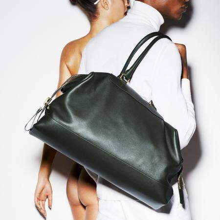 Tom Ford handbag e-commerce site - naked women selling handbags - Tom Ford bag collection - designer handbags - man bag - shopping news - handbag.com
