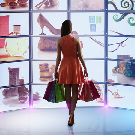 woman shopping - shopping online - how to buy clothes online successfully and safely - handbag.com
