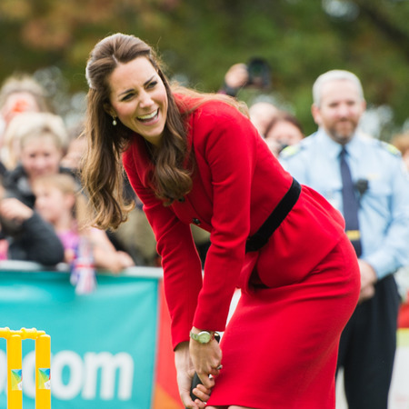 Kate Middleton laughing - playing cricket - new zealand tour - red suit - handbag.com