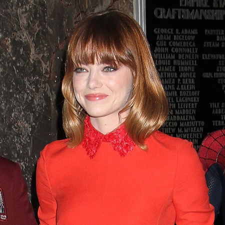 Emma Stone wears red dress to promote The Amazing Spider-Man 2 at the Empire State Building - celebrities matching their hair to their dresses - shopping bag - handbag