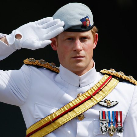 5 reasons prince harry would make a great boyfriend - prince harry doing a salute in uniform - day bag - handbag