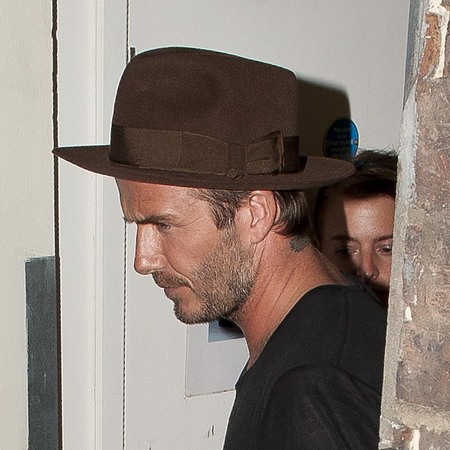 David Beckham wears hat to Victoria Beckham's 40th birthday party - david beckham fashion - celebrity men's fashion - fashion debate - day bag feature - handbag.com