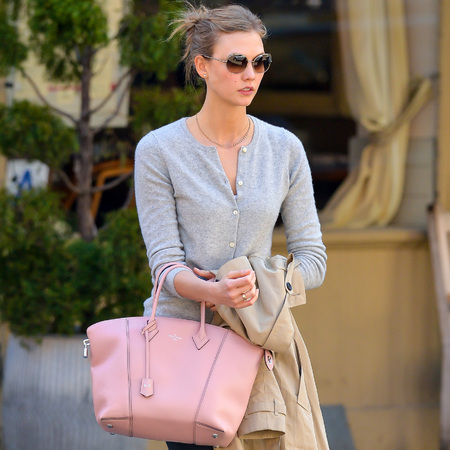 Karlie Kloss carries new Louis Vuitton Lockit bag - new Louis Vuitton It bag - Spring Summer 2014 designer handbag trends - celebrity handbags - shopping bag - news - handbag.com