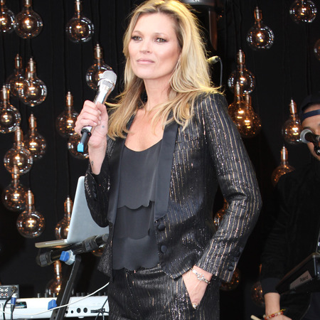 kate moss-topshop-clothing collection-launch-trousers and jacket-cami top-wearing own collection-handbag.com