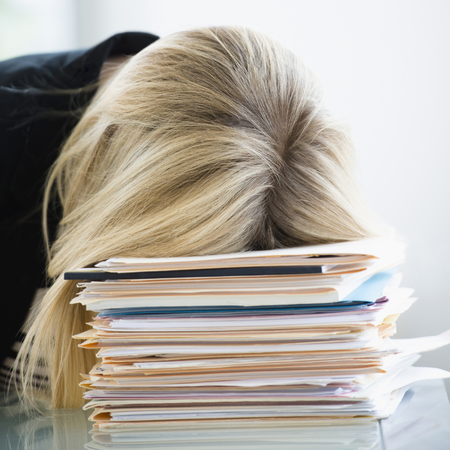 woman falling asleep at desk - study shows workers fall asleep at desks - 6 ways to get more energy - gym bag - handbag.com