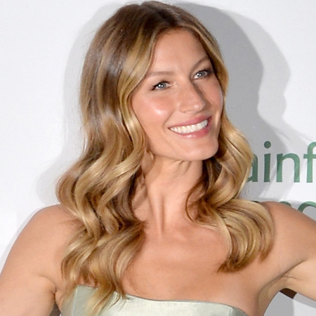 Gisele Bundchen-supermodel-green dress-hair inspiration-retro waves-smooth curls-rainforest alliance event-handbag.com