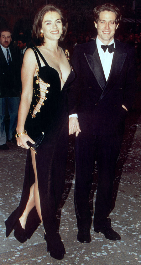 elizabeth hurley-hugh grant-safety pin dress-versace-20 year anniversary-lbd-sexy celebrity black dress-handbag.com