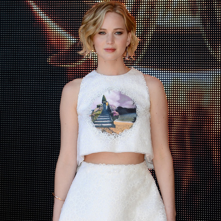 jennifer lawrence-cannes film festival 2014-hunger games mockingjay premiere-white skirt and top-christian dior-red carpet fashion-handbag.com