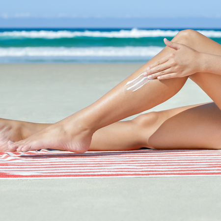 woman putting sun cream on which? worst sun creams results findings - shopping news - shopping bag - handbag.com