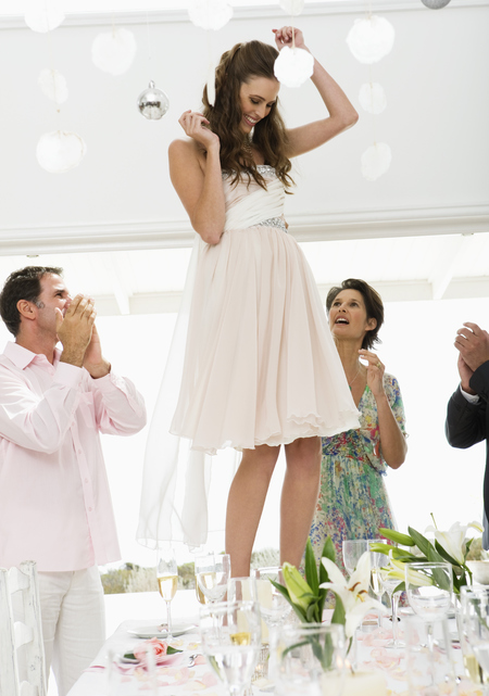 how to survive a wedding when you're single - drunk girl dancing on a table - evening bag - handbag