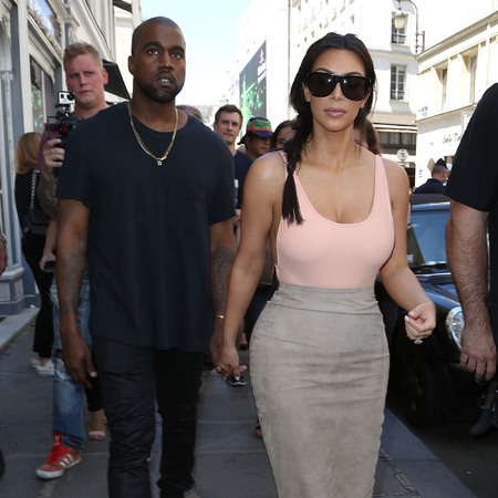 Kim Kardashian and Kanye West in Paris - side boob - leotard with skirt - no bra - handbag.com