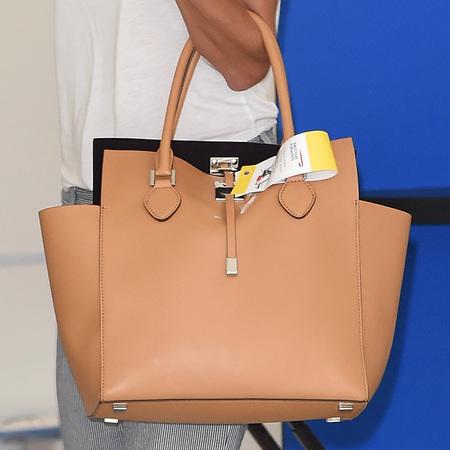 Alessandra Ambrosio - luxe luggage at Cannes - beige nude micahel kors miranda bag - handbag.com
