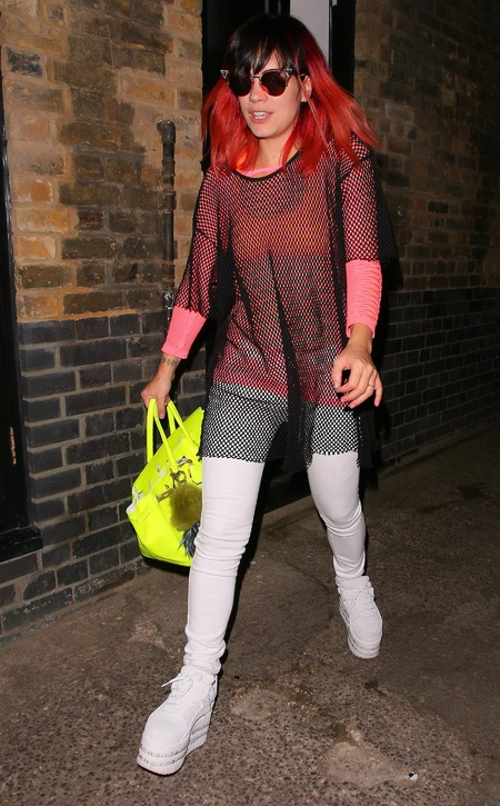 Lily Allen - ashish for tophsop - led trainers - mesh top - fluro handbag - handbag.com