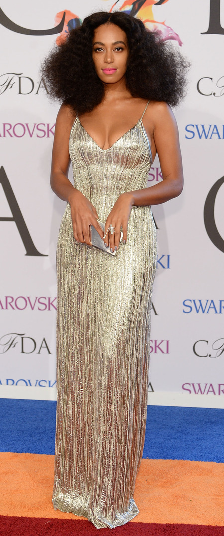 Solange Knowles on red carpet at CDFA Fashion Awards - Gold Clavin Klein dress - Jay Z Beyonce fight - celebrity fashion - handbag.com