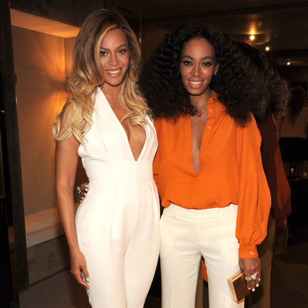 Beyonce and Solange - chime for change - white jumpsuit and seventies look - happy family - handbag.com