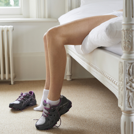 woman lying on bed - exercise - motivation - late sleepers don't stick to exercsie - gym news - gym bag - handbag.com
