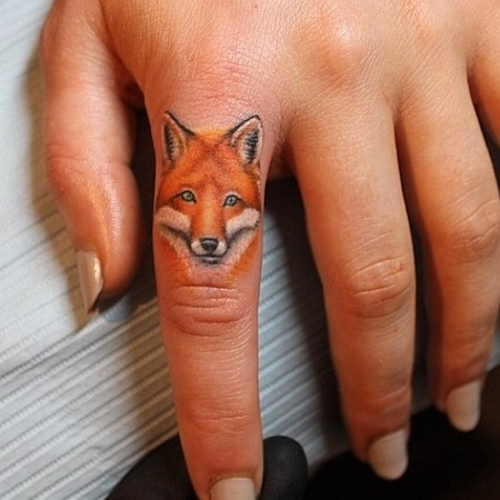 Cara Delevingne starts finger tattoo trend - fox tattoo - new tattoo trend - fashion news - day bag - handbag.com