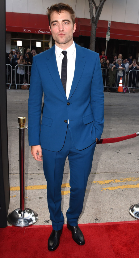 Robert Pattinson wears blue Alexander McQueen suit at Rover premiere - moves on from Twilight in new film - Robert Pattinson and Kristen Stewart - celebrity fashion - film news - day bag - handbag.com