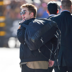 Robert Pattinson carries black duffel bag - Robert Pattinson fashion - celebrity street style - celebrity spots - #HandbagSpy - shopping bag news - handbag.com